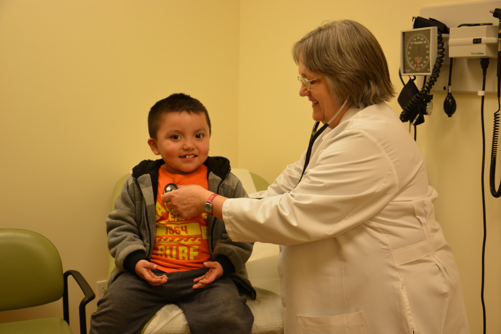 An LCH Nurse Practitioner checks the heart rate of a young patient.