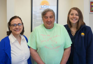 LCH patient, Dawn, with her caseworkers at LCH.