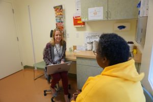 BHC meets with patient in exam room