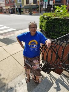 Cathy, an LCH patient, stands with a smile in downtown Oxford.