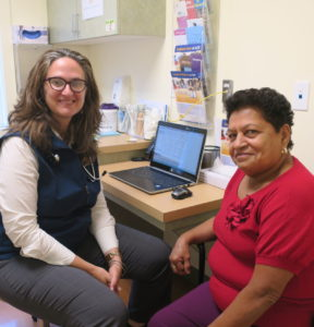 Photo of Certified Family Nurse Practitioner Jessica Fuentes, MSN, CRNP, with female patient in exam room for primary care visit