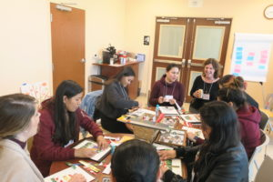 Photo of Teri Noone, CNM, facilitating a group visit with prenatal patients during December visit