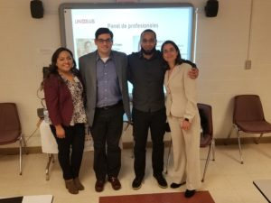 Panelist group smiles as a group after STEM presentation.