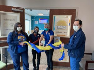 Photo of ribbon cutting ceremony at LCH pediatric office with staff