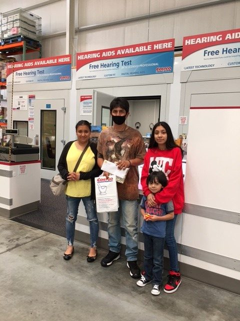 Rogelio and his family at Costco waiting for his hearingaids