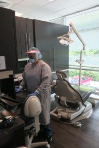 Image of Dental team preparing exam room