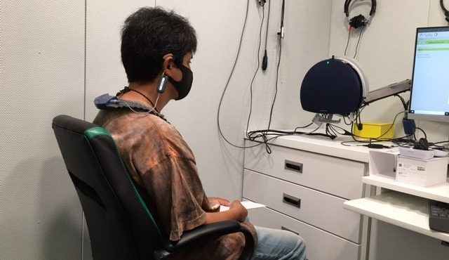 Rogelio gets fitted for hearing aids